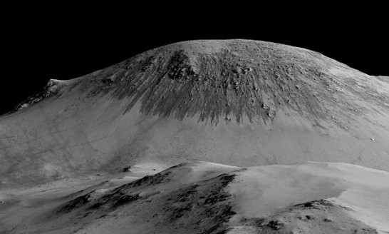Satellite images have identified narrow streaks that appear on slopes during warm seasons, lengthen, and then fade when conditions become cooler. Photograph: Nasa/JPL/University of Arizona/PA
